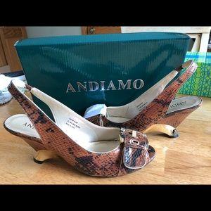 Heeled sandal new. Beautiful animal embossed.